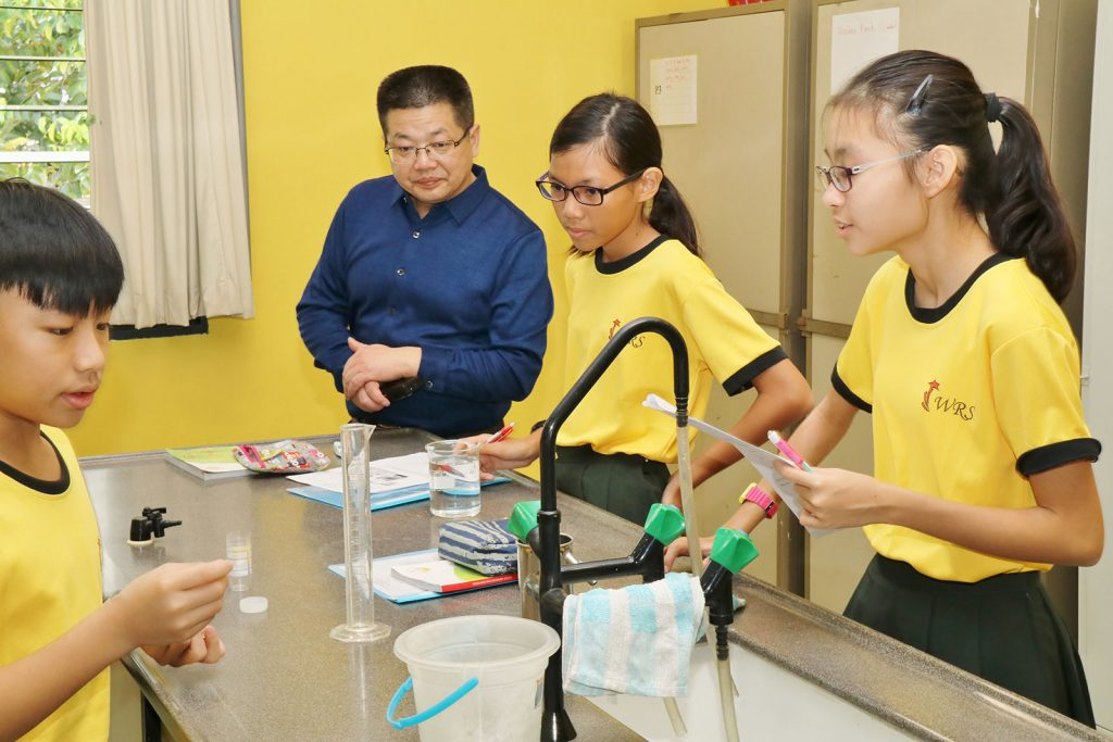 An educator from Chengguan Middle School observing our lessons in the Science Labs